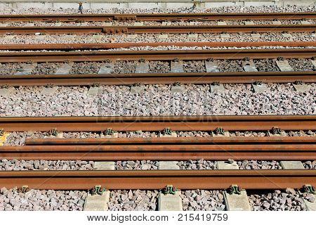 Background of rusty railway line tracks.