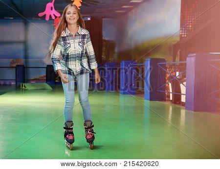 Charming teenage girl at roller skating rink