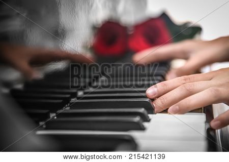 Talented woman playing piano, close up