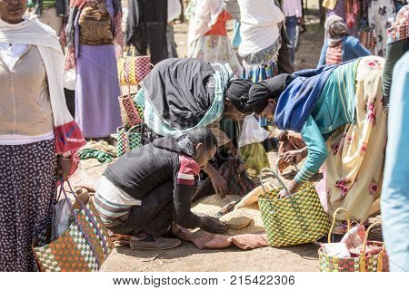 OROMIA, ETHIOPIA-NOVEMBER 1, 2017: Unidentified people buy and sell grain in an outdoor market in Ethiopia.