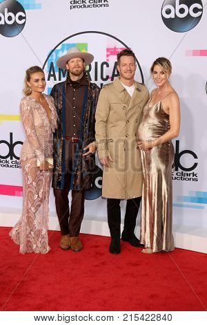 LOS ANGELES - NOV 19:  Brittney Marie Cole, Brian Kelly. Tyler Hubbard, Hayley Stommel at the American Music Awards 2017 at Microsoft Theater on November 19, 2017 in Los Angeles, CA