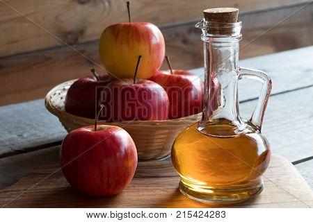 A Bottle Of Apple Cider Vinegar With Apples
