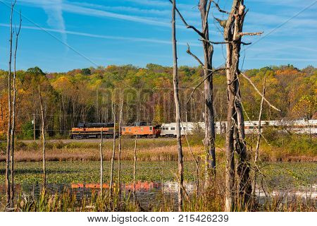 CUYAHOGA FALLS OH - OCTOBER 27 2017: A passenger train on the Cuyahoga Valley Scenic Railroad passes by Beaver Marsh in Cuyahoga Valley National Park south of Cleveland.