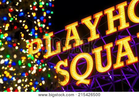 Cleveland OH - Jan. 1 2016: The Playhouse Square sign on Euclid Avenue in Cleveland next to a large brightly lit Christmas tree