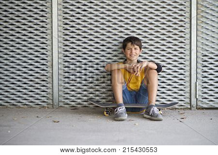 Casual dressed young teen skater outdoors portrait ( lifestyle )