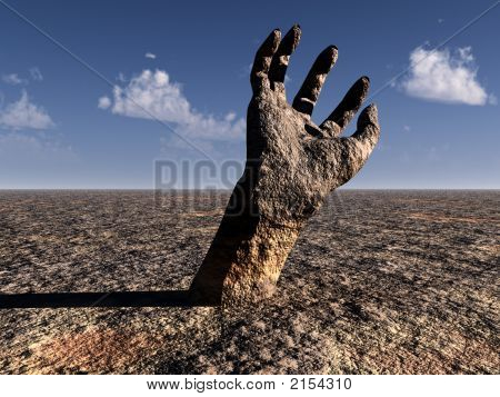 A conceptual image of a stone hand reaching out of the ground in a barren unfertile landscape poster
