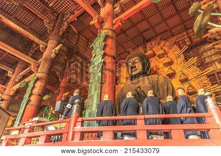Nara, Japan - April 26, 2017: monks in a row to celebrate the Great Buddha or Daibutsu, the world's largest bronze statue of Buddha Vairocana. Todai-ji Buddhist Temple in Nara.