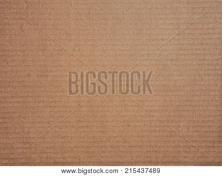Brown recycled old paper texture or brown craft carton old rough plain light cardboard background.