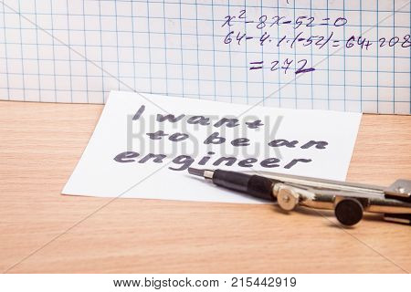 inscription I want to be an engineer of compasses and a notebook on algebra of dreams about a prestigious profession