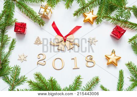 New Year 2018 background with figures Christmas toys with frame of green fir branches - New Year 2018 composition. Festive New Year 2018 still life. Holiday postcard with Happy New Year 2018 concept