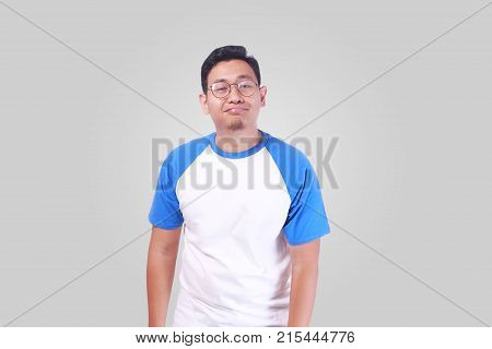 Funny Asian Man Gesturing Surrender Hopeless Smiling
