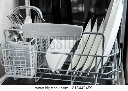 clean plates and other dishes after washing in the dishwasher. dishwasher inside
