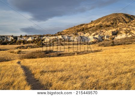 SUnset light over soapstone cliffs in  Red Mountain Open Space in northern Colorado as seen from Salt Lick Trail