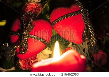 Valentine's day, flowers and heart before candle light