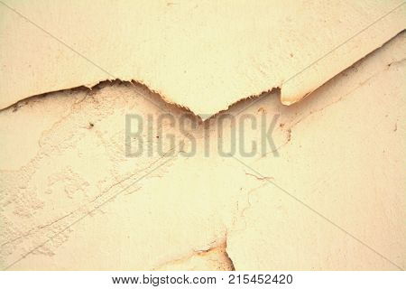 abstract yellow background on concrete wall with crack