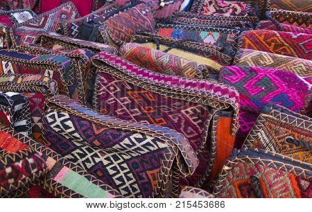 Bags headgear boxes made of traditional fabrics of Armenian patterns and colors lying on the stalls at the Yerevan market in Armenia