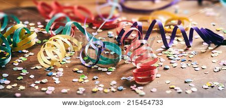 Colorful Confetti And Serpentines On Wooden Background