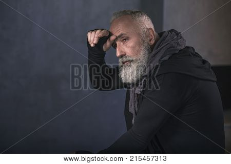 Side view serene unshaven retire expressing weariness. Copy space. Languor concept