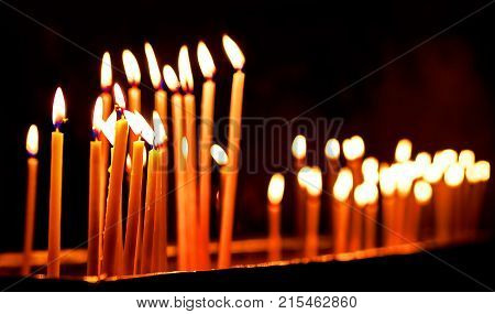 Burning candles. Celebration event or religious memorial attribute of warmth and sincerity.