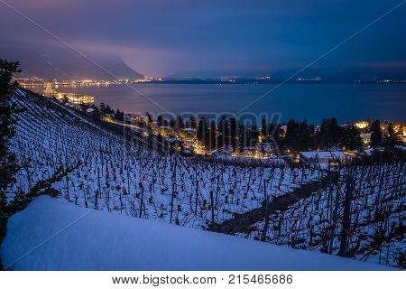 Montreux at night with view on Geneva lake in the background and vineyards under the snow