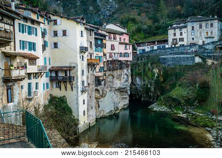 Pont-en-Royans in France with houses built on a cliff above the Isere river