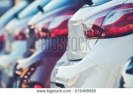 New Cars Production and Sales Concept Photo. Row of Brand New Vehicles For Sale.
