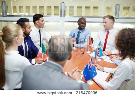 International politicians gathered together for discussion forum in boardroom