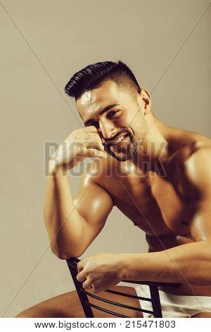 Handsome Bodybuilder Sits On Chair