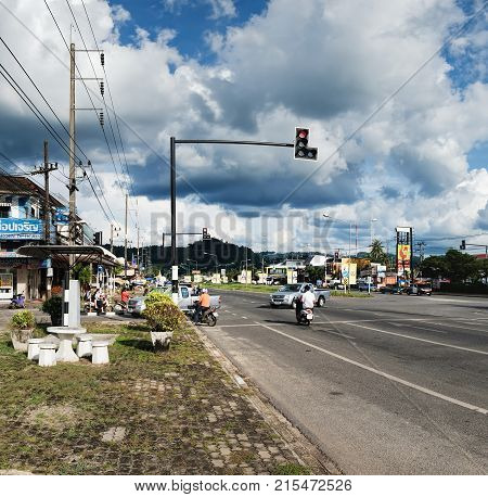 Takua Pa, Thailand - December 26, 2015: Everyday street life of the provinces of Thailand. Takua Pa is located on the main route to the tourist coast of the Andaman sea - Phuket Island and Khao Lak