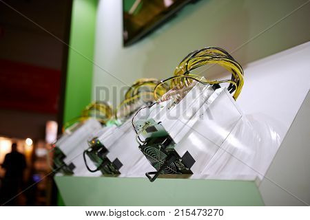 Cryptocurrency mining equipment - ASIC - application specific integrated circuit on farm stand gain money