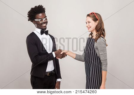 African Man And Freckles Caucasian Woman Handshake And Toothy Smiling