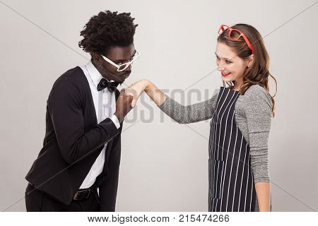 African Man Kissing Hand Caucasian Woman, And She Smiling.