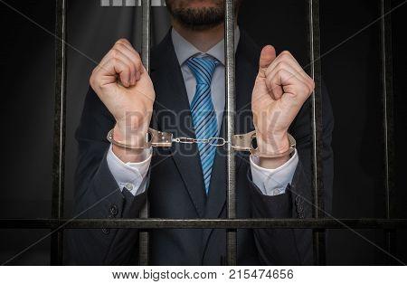 Arrested Prisoner Is Holding Bars In Prison Cell.
