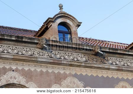 BARCELONA, SPAIN - MAY 12, 2017: It is an architectural fragment of the eaves of the building of the Parliament of Catalonia.