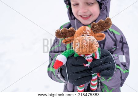 Little Boy Having Fun In The Snow