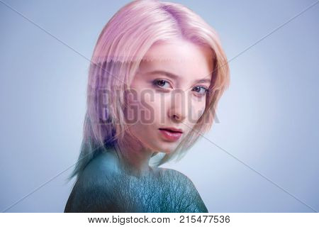 Unearthly beauty. Portrait of a confident millennial lady posing with no smile on her face and looking into the camera invitingly.