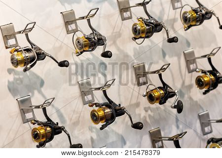 Baitcasting reel on fishing rods in sport shop Fishing