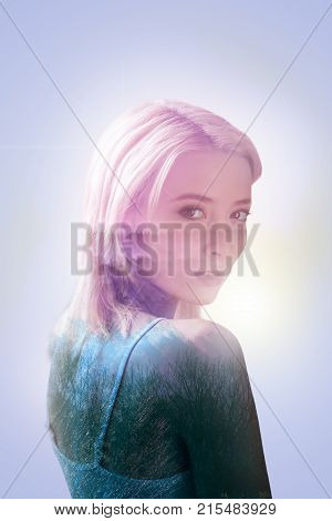 Beautiful lady. Nice pleasant beautiful woman turning to you and looking at you while standing against grey background