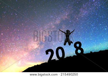 Silhouette Young Man Happy For 2017 New Year Background On  The Milky Way Galaxy Pointing On A Brigh