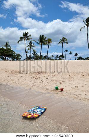 Boogie Board And Beach Balls On A Tropical Beach