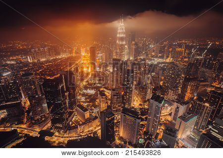 Aerial Skyline View To Kuala Lumpur City, Malaysia. Business Skyscrapers Night Downtown Background