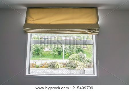 beige curtain at the window in bedroom
