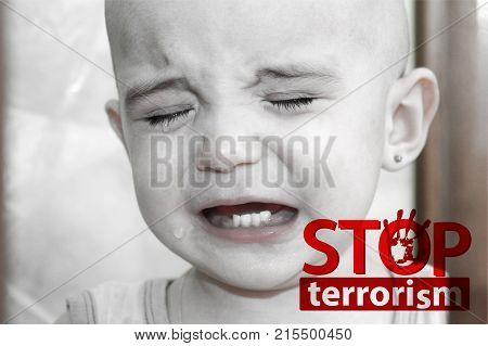 stop terrorism concept. children's tears. children and war. crying baby