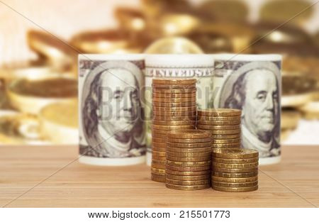 A hundred dollars with coins business concept