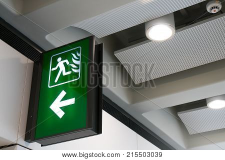 Fire Exit Sign Lightbox In The Airport Terminal Emergency Exit Way. Green Emergency Exit Sign Direct