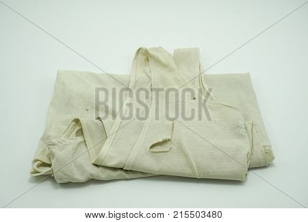 Old Tank Top is lacking on white background closeup at lacking sufficiency economic concept