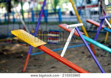 Seesaw or teeter-totter in playground for childhood