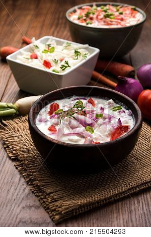 Onion, Carrot, radish raita also known as Koshimbir. It a condiment from the Indian subcontinent, made with dahi / curd together with raw / cooked vegetables like onion, Gajar / Carrot, Mooli, Radish