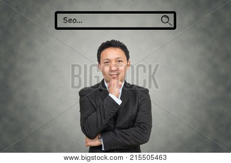 Asian businessman with browsing of Internet searching
