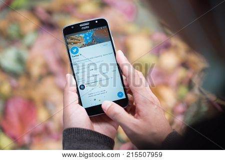 CHIANGMAI THAILAND - NOV 9 2017 : Man hand holding Moto g5s Plus open Twitter application Twitter is an online social networking and microblogging service that enables users to send and read